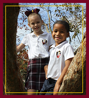 Two Students in tree smiling