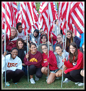 Students pose with American flags