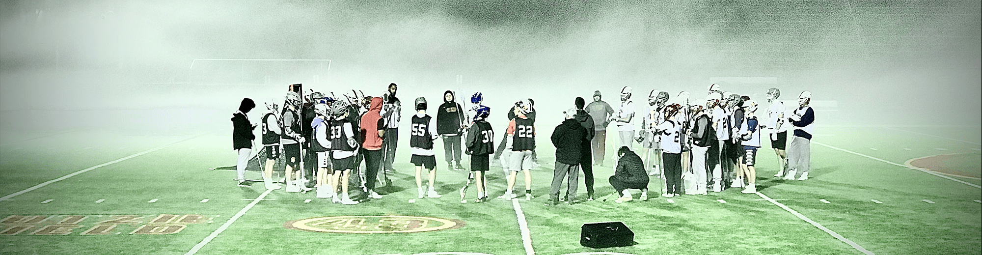 Lacrosse team standing together on a field