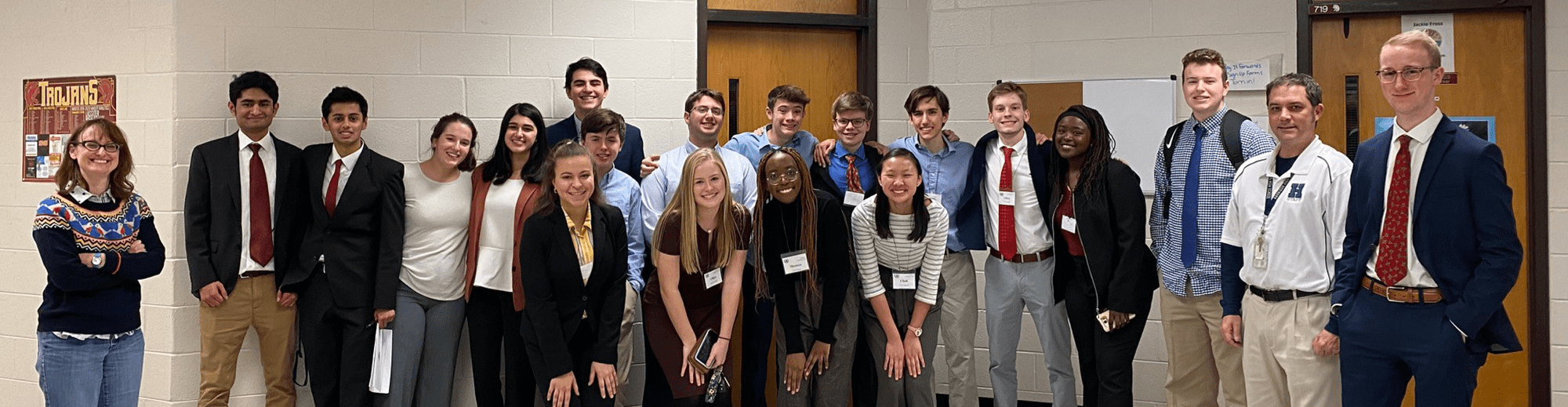 Model UN members posing together in a hallway