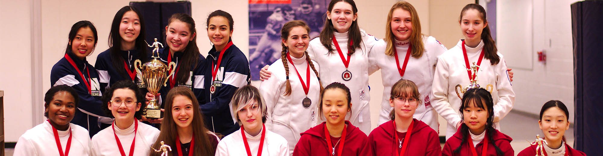 Womens Fencing Team smiling with trophies
