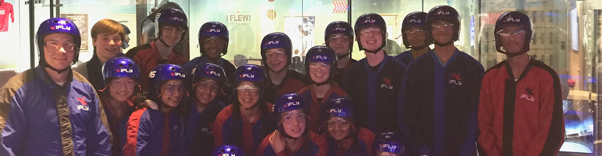 Students and adults pose at iFly
