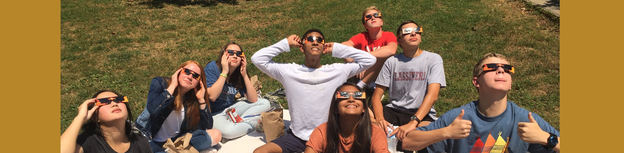 students watching the solar eclipse