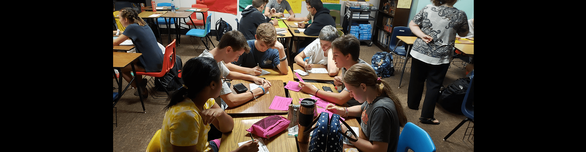 Students participate in an escape room activity together in a classroom