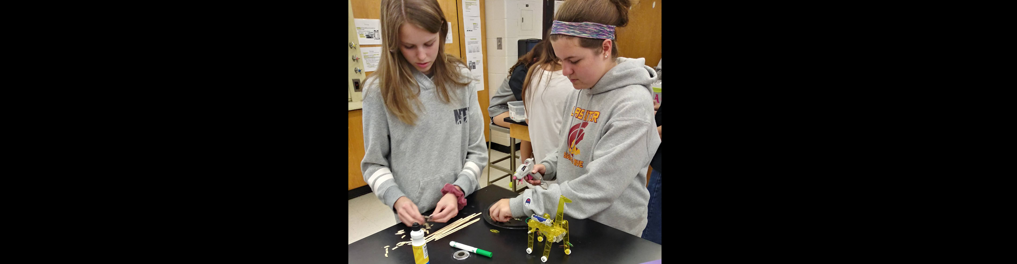 two female students working on a STEM project