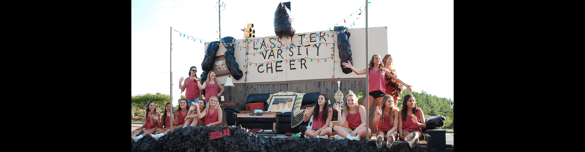 Lassiter Varsity Cheerleaders pose on their Stranger Things float outside
