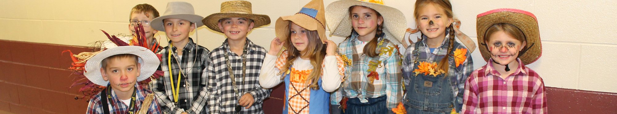 young students dressed up as scarecrows