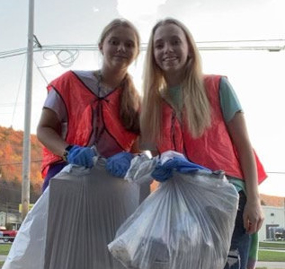 students with trash bags