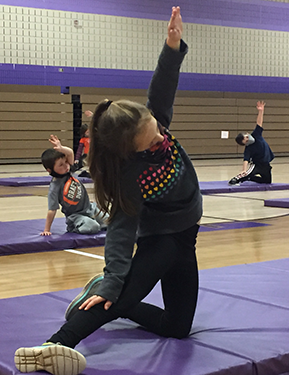 students doing Yoga in gym