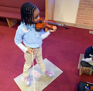Student standing with violin