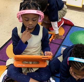 Elemenary school girl learning on a tablet