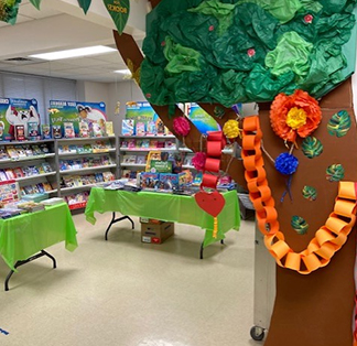 School library decorated with colorful books and tree