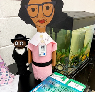 Student bottle puppets on display in the classroom