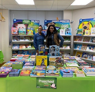Two parents in front of book fair