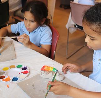 Students enjoying painting together
