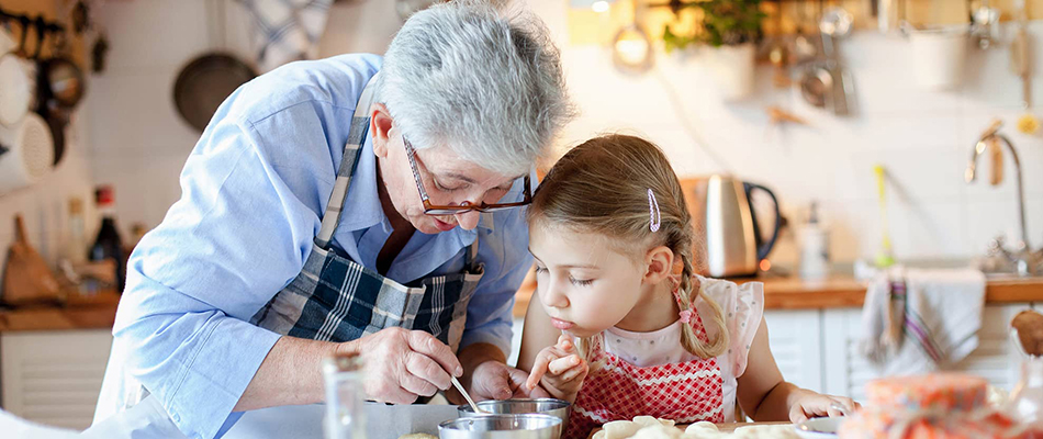 Grandmother and granddaughter baking together