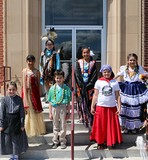 Group of students outside wearing ethnic costumes