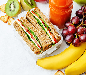 School lunch with sandwich and fruit