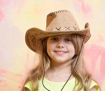 Elementary school girl wearing cowboy hat