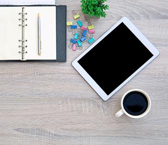 iPad, coffee, and notebook on teacher desk