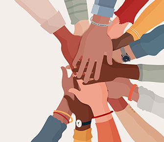 Group of hands on top of each other showing unity