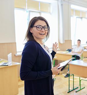 Happy teacher in front of her class
