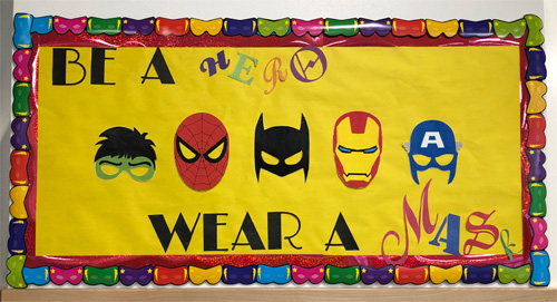 Be a hero. Wear a mask hallway display
