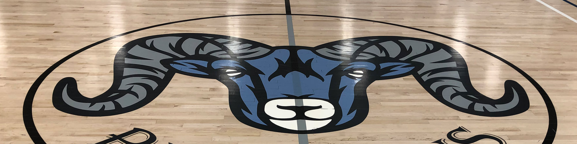 ram mascot logo on gym floor