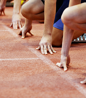 runners lined up at a track meet