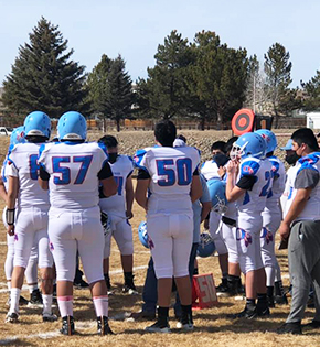 Football players huddled up during a game
