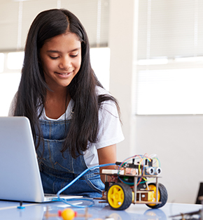 Middle school girl building a robot