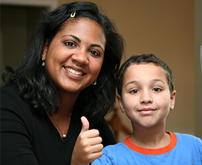 teacher and student giving a thumbs up