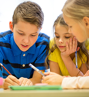 three kids working on an assignment together