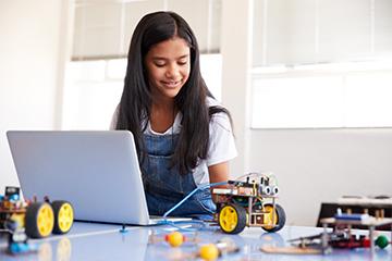 Female student working on robotics project