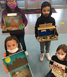 Students with shoe box projects