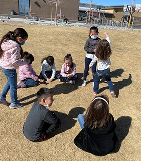 Group of students out on the playground enjoying the outdoors