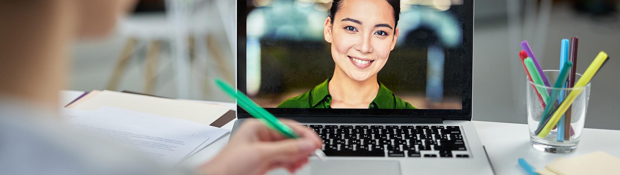 NNVA teacher on student laptop via online class