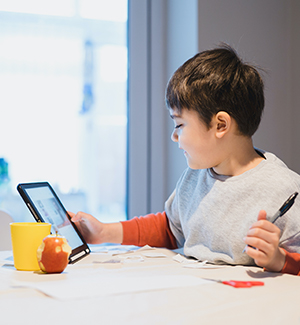 Young student engaged in learning from home