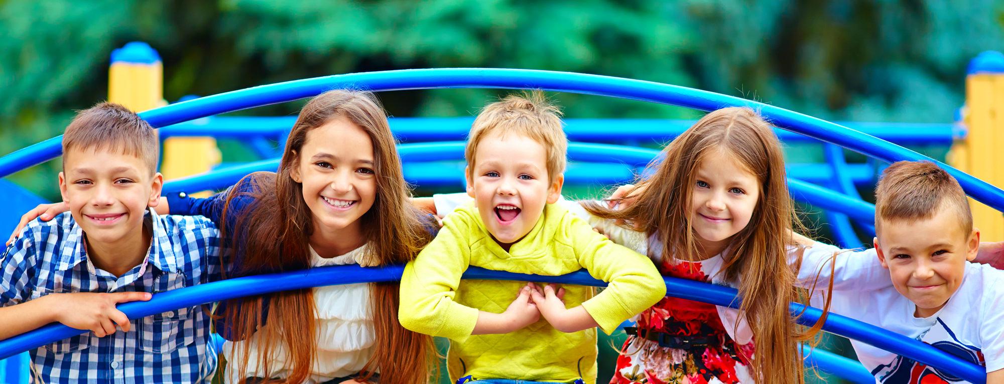 students sitting on playground equipment