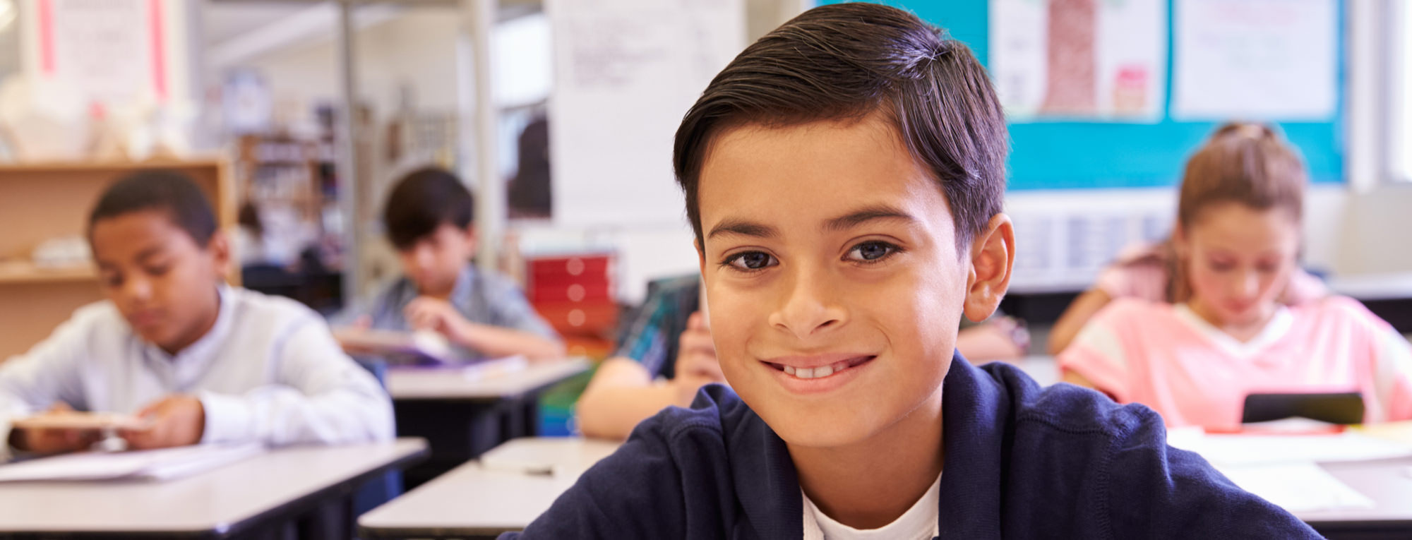 smiling student in a classroom