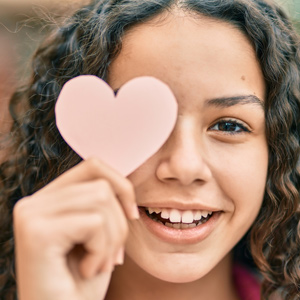 student holding paper heart