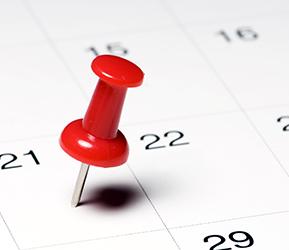 red thumbtack in calendar