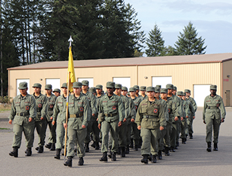 group of students in uniform marching