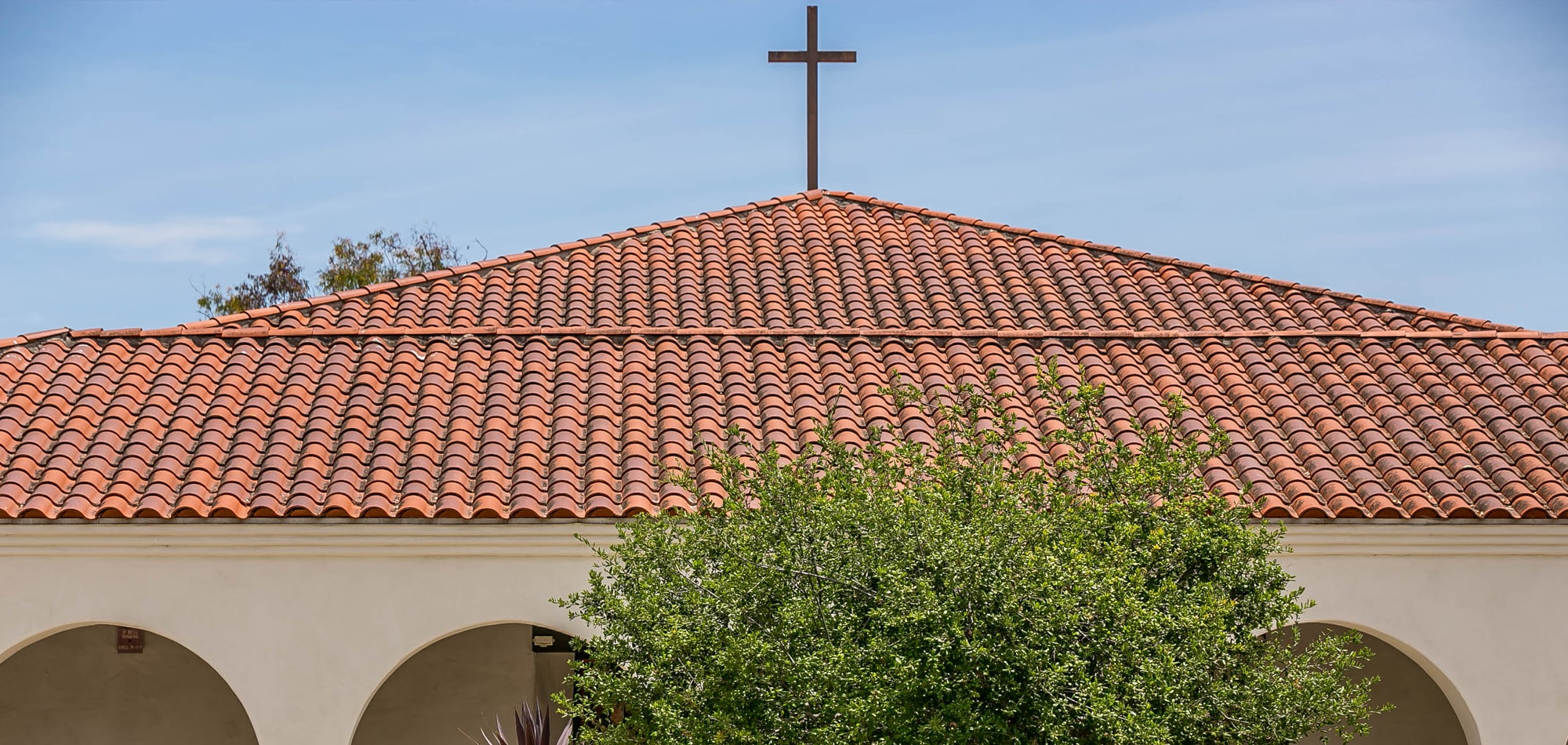 roof of Nazareth School with cross on top