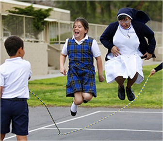 students playing jump rope with a sister