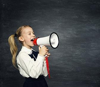 child in uniform with megaphone