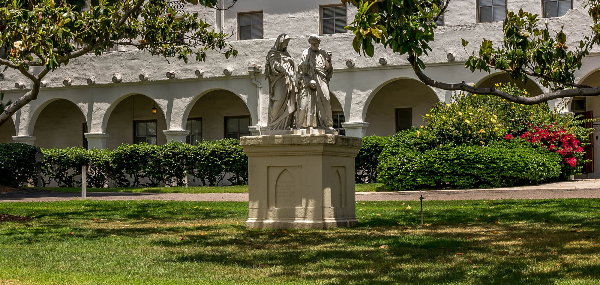 front view of Nazareth School of San Diego with religious statue in front
