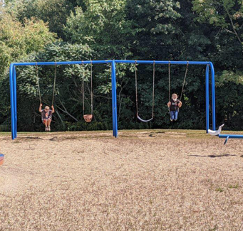 students on a swingset