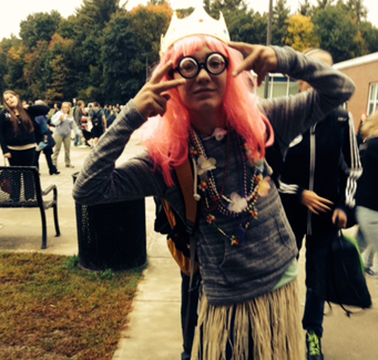 staff member dressed up with pink hair and glasses