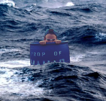 teenager peeking out of a can in the ocean